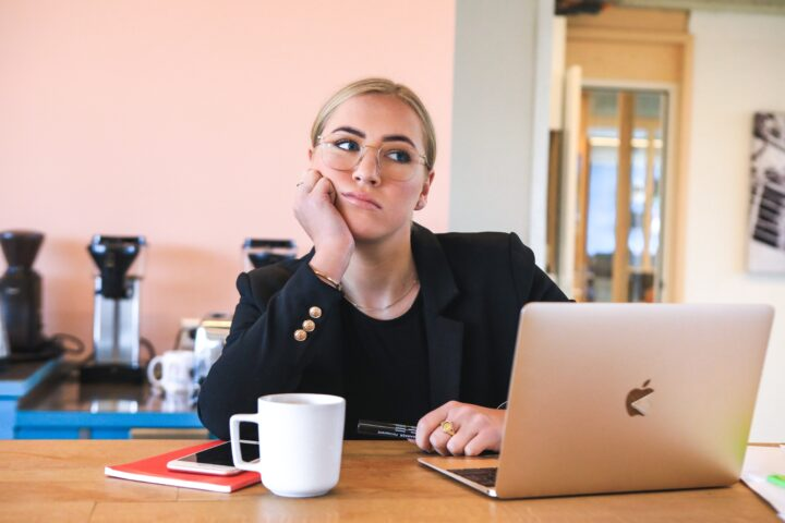 Woman working from home, who is feeling isolated and disengaged